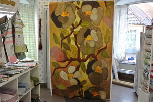 Kinnamark flowery orange och grön