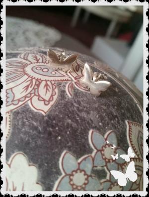 Fjärils örhängen i silver