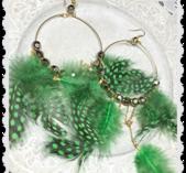 Stora gröna fjäderörhängen