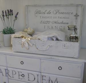 Old white suitcase with french text