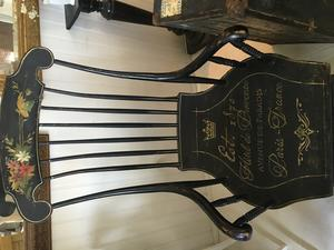 Rocking chair with french script in gold