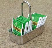 Tepåshållare i rostfritt
